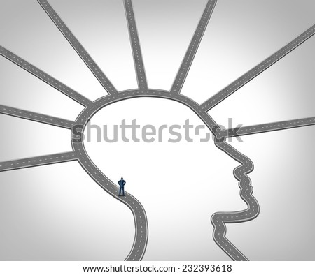 Career Direction and job opportunity through training and professional skill development as a businessman standing on a road or path shaped as a human head face as a concept for employment success. - stock photo
