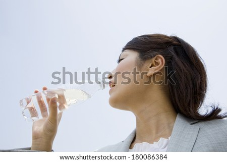 Career Japanese woman drinking water