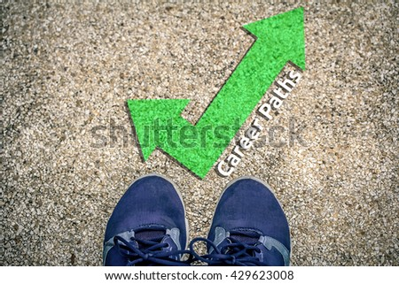 career path concept  - feet on floor with direction arrows - stock photo