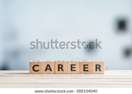 Career sign on a wooden desk in an office - stock photo