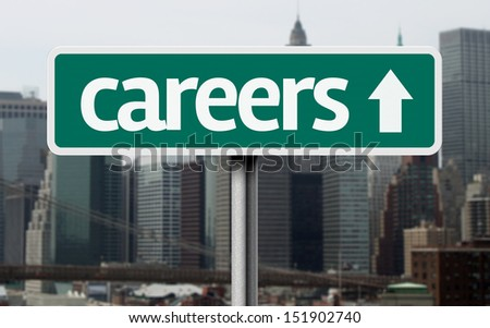 Careers road sign and a business city in the background  - stock photo