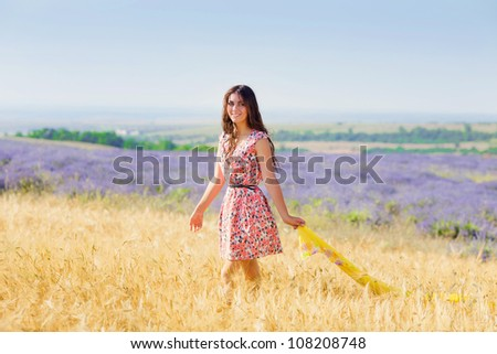 Carefree adorable girl with in fairy field. Summer freedom enjoy concept - stock photo
