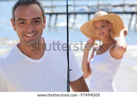 Carefree couple on holiday together - stock photo