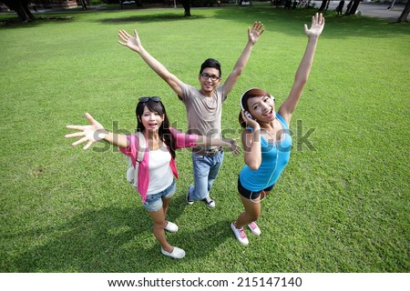 Carefree Happy College students and smile to you on campus lawn, asian - stock photo