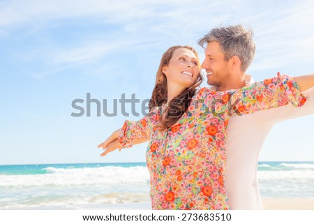 carefree pair of younger adult man and girlfriend - stock photo