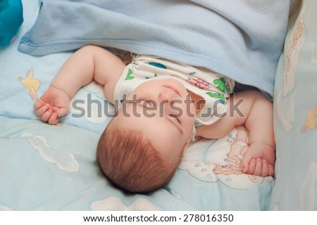Carefree sleep little baby in the bed - stock photo