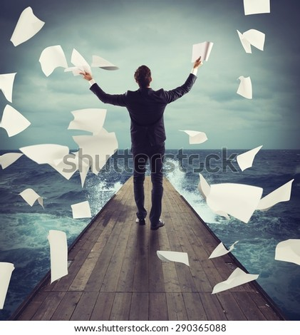 Carefree successful man throws in air documents - stock photo