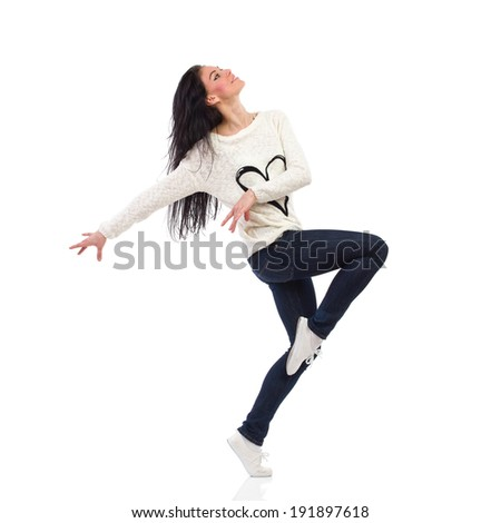 Carefree woman. Cheerful female dancing with arms outstretched. Full length studio shot isolated on white. - stock photo