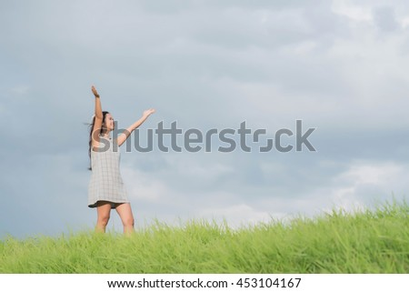 Carefree woman having a good time at the meadow