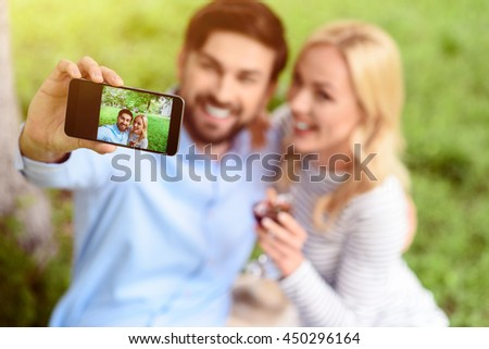 Carefree young man and woman in nature