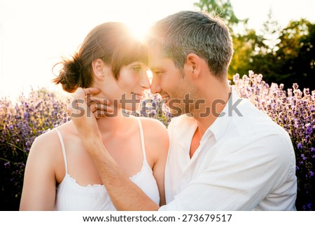 carefully touching face of girlfriend