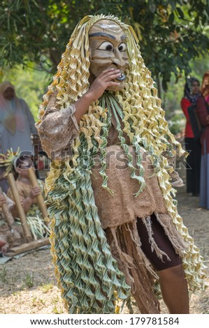 CAREY ISLAND, SELANGOR,MALAYSIA - MARCH 1, 2014 : Unidentified man of Mah Meri tribe dances during the Ari Moyang (Ancestors Day) celebration in Pulau Carey Island, Klang, Malaysia. - stock photo