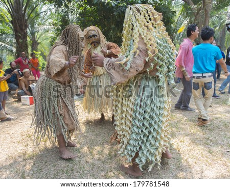 CAREY ISLAND, SELANGOR,MALAYSIA - MARCH 1, 2014 : Unidentified people of Mah Meri tribe dance during the Ari Moyang (Ancestors Day) celebration in Pulau Carey Island, Klang, Malaysia.