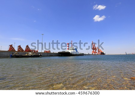 cargo berth under blue sky, closeup of photo