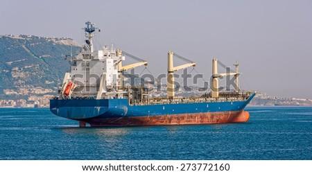 Cargo bulk vessel passes the Strait of Gibraltar - stock photo