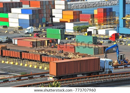 Cargo container, pipe, lumber and train in port