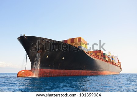 cargo container ship anchored near harbor - stock photo