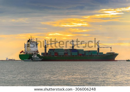 Cargo container ship at sunset - stock photo