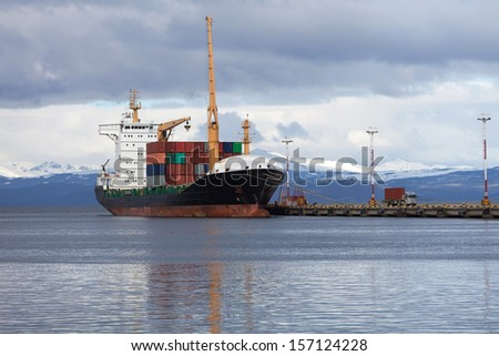 Cargo container ship in the port - stock photo
