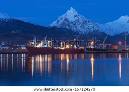 Cargo container ship in the port of Ushuaia, Argentina - stock photo