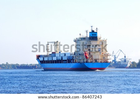 Cargo container ship sailing in the port