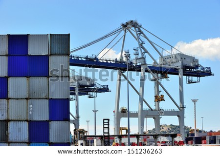 Cargo cranes are working at the port of Auckland, New Zealand.