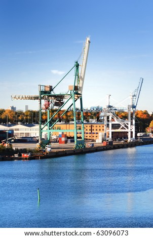 cargo cranes at the port of Stockholm - stock photo