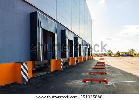 Cargo doors at big industrial warehouse building - stock photo