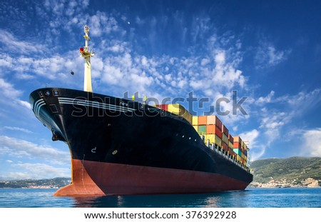 cargo freight, container ship in sea - stock photo