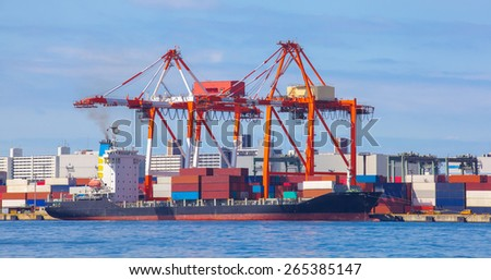 Cargo freight ship with stacked container at harbor terminal..