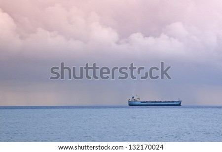 Cargo ocean liner in sea with storm - stock photo
