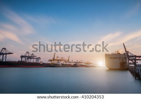 Cargo or Trade Shipping Port at sunrise