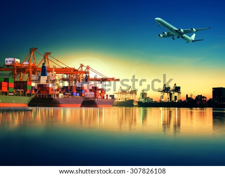 cargo plane flying above ship in port for logistic and transport industry - stock photo