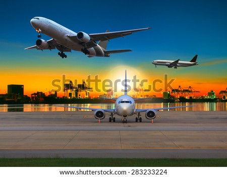 cargo plane flying over airport against beautiful morning light in ship yard use for transportation and logistic industry business - stock photo