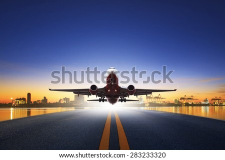 cargo plane take off from airport runways against ship port background use for air transportation and cargo logistic industry ,import ,export business  - stock photo