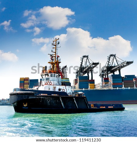 Cargo sea port. Sea cargo cranes. Tug. - stock photo