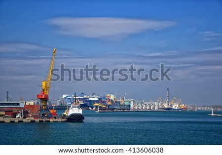 Cargo sea port with crane, ship and harbor on beautiful sky background