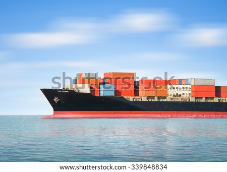 Cargo ship and cargo container in sea with sky background. - stock photo