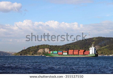 Cargo Ship at Bosphorus in Istanbul, Turkey. - stock photo