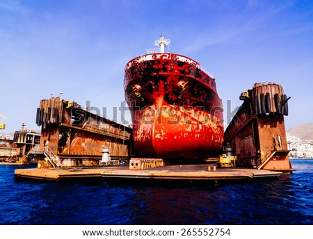 Cargo ship at dock - stock photo