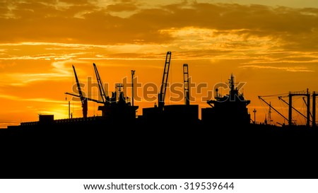 Cargo ship at sunset time in beautiful light - stock photo