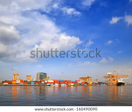 Cargo ship at the port for transportation with blue sky  - stock photo