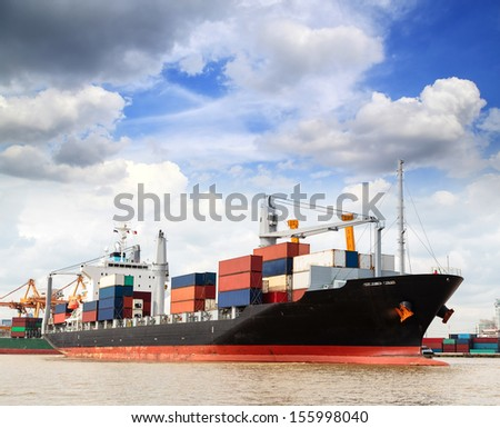Cargo ship at the port outgoing with blue sky