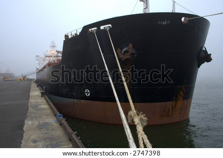 Cargo ship being unloaded