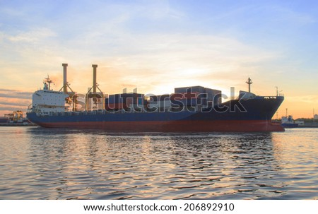 Cargo ship (Bulk carrier) loading in cargo terminal  - stock photo