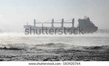 Cargo ship (Bulk carrier) sailing. Riga, Latvia - stock photo