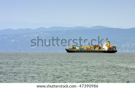 Cargo ship by the shore.