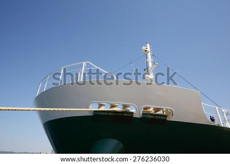 Cargo ship docked in the port - stock photo