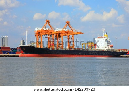 Cargo ship empty on loading in the harbor .  - stock photo