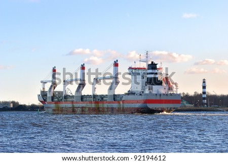 cargo ship entering the port of Riga